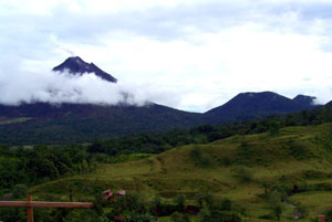 Arenal Volcano and its companion Cerro Chato constant visual stimulation as the clouds and light often play around them and the lava flows from the volcano cascade down the mountainside at night.