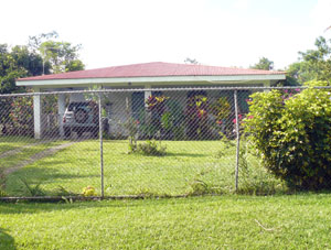 The property begins at the paved road to Tronadora where this 3BR 2BA house is situated. The house is an optional purchase. Its lot occupies just a part of the property's road frontage.