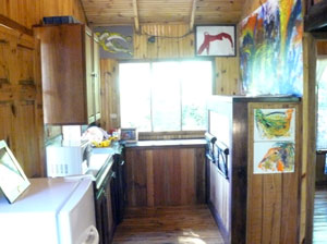 The kitchen has modern appiances and nice native hardwoods.