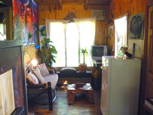 The living room in each cabin is small but pleasant and furnished with clever rustic furniture.
