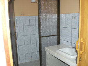 The bathrooms tidy and tiled and have showers.