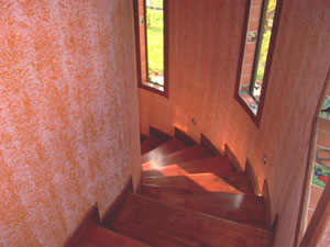 The handsome curving stairwell leads to the second-floor suites.
