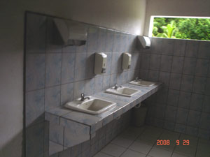 The facilities include a bank of modern tiled hand basins.