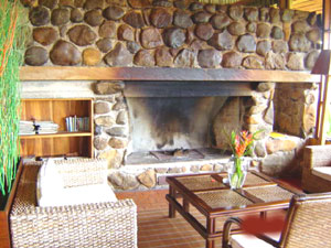 The great rock fireplace in one of the comfortably furnished common areas