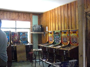 A row of game machines is located on the main floor.
