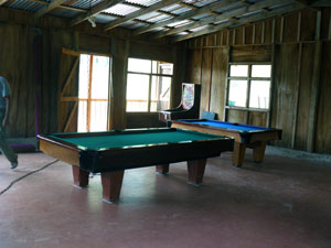 A very large second-floor space now houses just 2 pool tables.