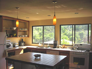 The kitchen is a roomy place with large windows and a center island.
