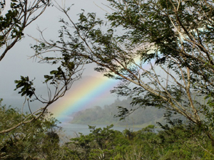 The rainbow hovers over nearby San Luis Cove, where there is a marina.
