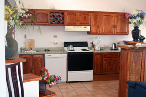 The kitchen's custom cabinetry is extensive and beautiful.