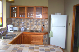 Very nice tile and woodwork make the kitchen a charming place.