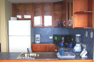 The kitchens have fine wood and tile work.