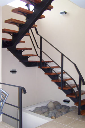 The innovative design includes this graceful stairway.