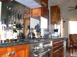 The kitchen has top appliances, including a huge Italian gas range.