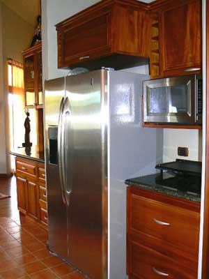 The fine kitchen appointments include this massive refrigerator.