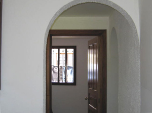 The Spanish colonial motif is carried out with arched doorways.