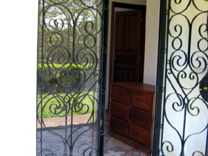 The entrance has attractive wrought iron security doors.