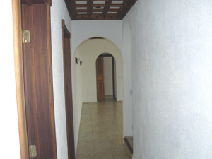 From the entrance a short hallway leads to a laundry room, the stairs to the tower, and the living room.