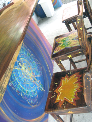 Colorful artistry decorates the table pedestal and the chairs.