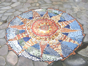 Mosaic sun was made onsite by local artists.