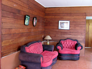 The cabina has warm wooden walls.