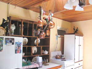 The large kitchen has a high wooden ceiling with a skylight.