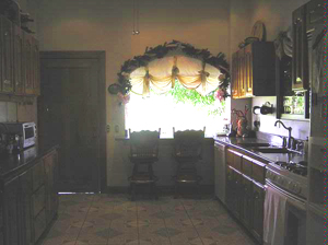 The large kitchen plenty of room and custom cabinetry.
