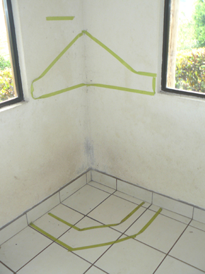 Tape outlines the location of the sculptor's plan for a fireplace.