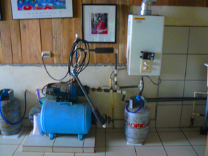 The house has stalwart infrastructural features such as this powerful water pump and in-demand hot water heater.