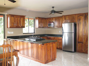 The kitchen is a well designed roomy space with fine appliances and woodwork.