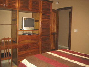The second bedroom has a bathroom and built-in closet with desk of fine Guanacaste hardwood.