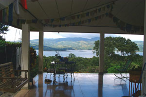 The wide house-wrapping patio is a great place to relax and enjoy the lake and 3-volcano vista.