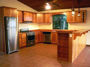The large kitchen has stainless steel applinces and lots of custom hardwood cabinetry.