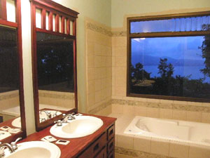 The bathrooms also have beautiful vistas from this secluded location.