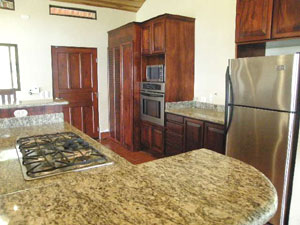 Casa Fiesta is fully outfitted with fine appliances including a gas range built into the large kitchen island.