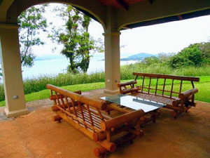 The wide patio of the lower house, furnished with two sets of outdoor furniture, is a wonderful place to enjoy the balmy climate and the views.