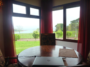 The dining area looks over the nearby cove and the lake beyond.