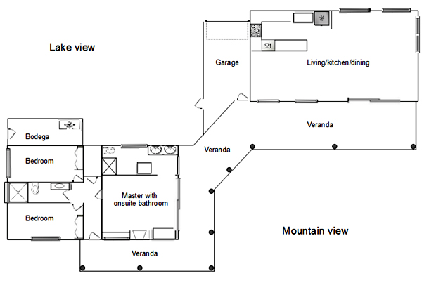 The floor plan shows the two buildings - bedroom and common areas - joined by the veranda.