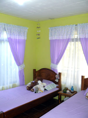 A chilren's bedroom has a bright color scheme.