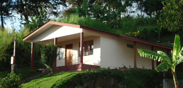 The 2-bedroom home is located right across the lake highway from a pretty arm of Lake Arenal.