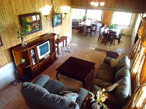 The huge-L-shaped open area turns the corner from the kitchen and dining area into a large, living room with cathedral ceiling.