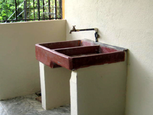 There's roomy laundry area with the traditional Tico double-sided laundry sink.