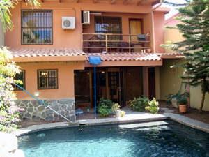 A lovely pool fills te back yard of te two-story, 4 BR home.