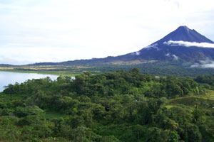 The northwestern flank of the Volcano extends toward Lake Arenal.
