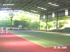 A roofed tennis court at the marina community