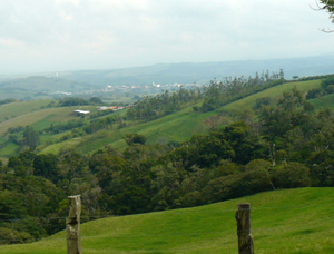 To the northwest are Tilaran, wind turbines atop hills beyond the town, and the Guanacaste lowlands.