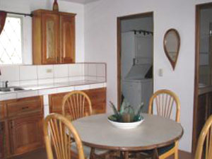 The kitchen is fully equipped with dishes and appliances.