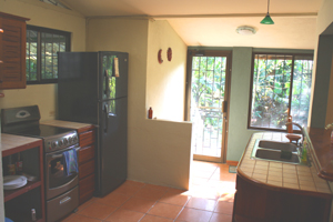The kitchen with door to patio.