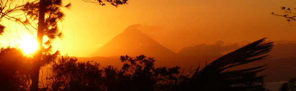 The sun rising behind the Arenal Volcano makes a beautiful view from this property.