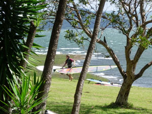 A windsurfer leaves the famous windsurfing end of Lake Arenal.