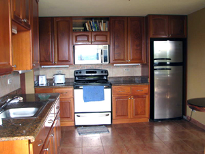 The kitchen is fully outfitted and has new appliances.